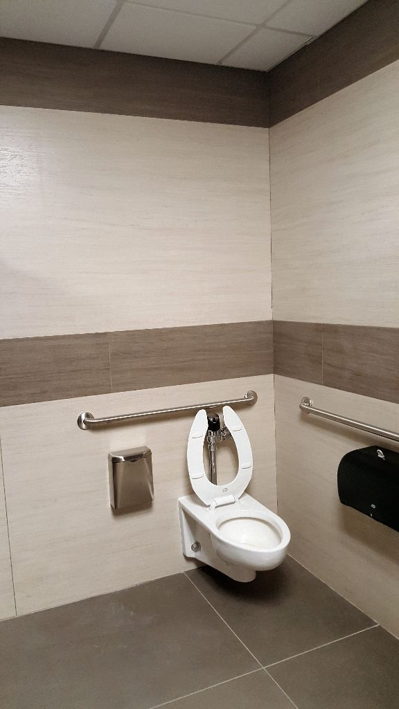 Crossville's Laminam collections transform restrooms at a Syracuse community college in a tile-over-tile installation that ensured ADA compliance.