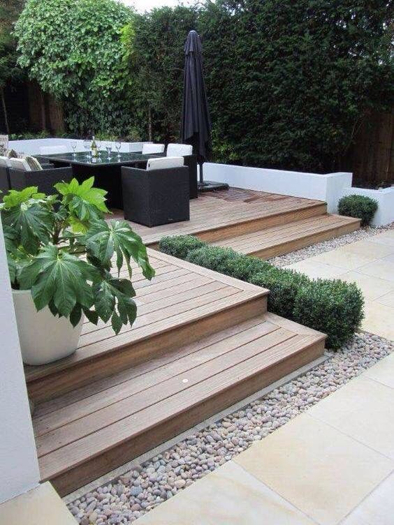Wood deck with rock border at pool fence
