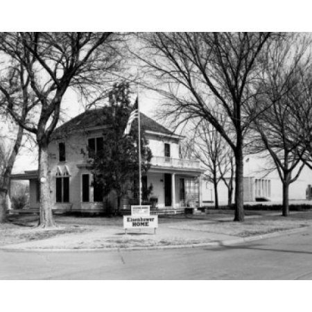 Flag in front of a house Dwight D Eisenhower Family Home Abilene Kansas USA Canvas Art - (24 x 36)