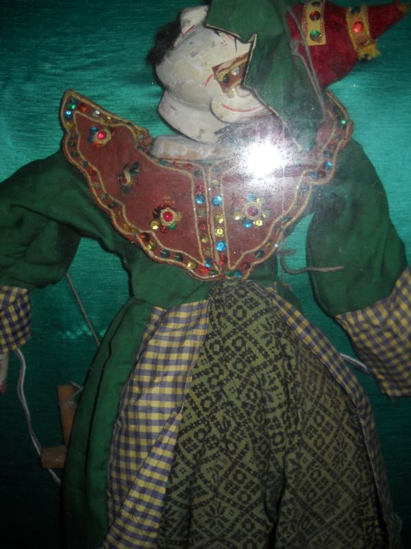 Antique marionette framed in a shadow box - close-up detail