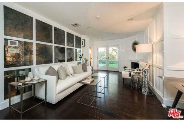Mila Kunis' sitting room...smoked mirror wall with window pane effect.SB