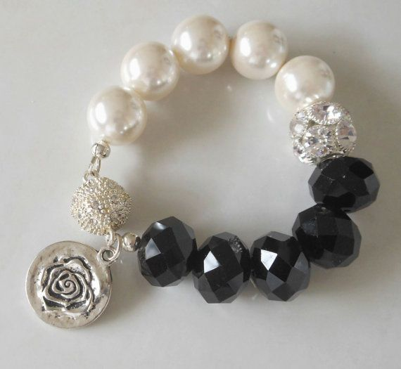 Crème Pearls & Mega Black Crystals Bracelet by KatsuJewellery https://www.etsy.com/listing/128093376/creme-pearls-mega-black-crystals?ref=shop_home_active