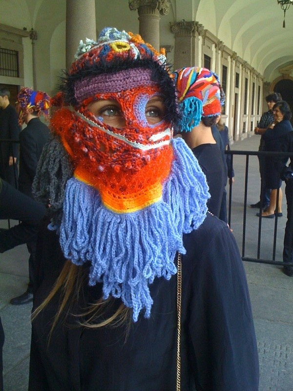 """Aldo Lanzini is the artist who designed these amazing knitted masks for Angela Missoni at her fashion show on Sunday, September 26th, in Milan. At the entrance of the Missoni show, a group of individuals were wearing crocheted masks from Aldo's series """"The eyes are there where they see, the things are there where they are seen."""""""