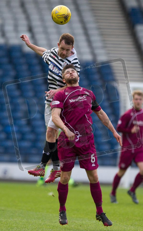 Queen's Park's Vinnie Berry wins the header during the SPFL League Two game between Queen's Park and Arbroath.