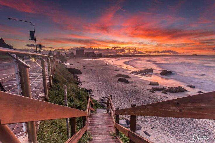 Take a sunset walk along Kirra Beach