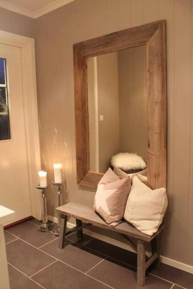 Create the illusion of a larger entryway with an oversized mirror and neutrals. | Weir's Furniture | Entryway | Home decor | Large Mirror