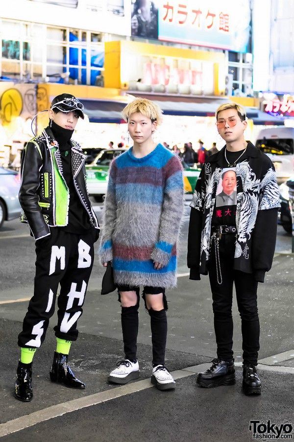 Ryunosuke, Daiki, and Yuuta are a trio of fashionable young men who we often see around the streets of Harajuku. Their looks here are punk-inspired. Ryunosuke – 17 years old, on the left – is wearing a studded leather jacket from his own brand over a 99%IS- turtleneck, graphic pants by MISBHV, and black patent leather boots. Accessories include a cap by the Harajuku streetwear brand BERCERK, 99%IS- sunglasses, and neon socks by TRAVS x 99%IS-. Ryunosuke's favorite shop is Never Mind The XU…