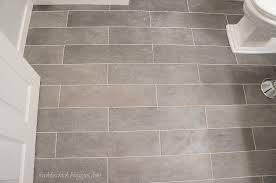 tile floor in the bathroom. Run it the width of the bathroom to make it appear wider than it is!