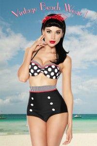 Bikini retro. Bikini estilo pin up que combina lunares y partes lisas. La parte superior tiene efecto push-up. La parte inferior es de corte alto y esta adornada con botones blancos.