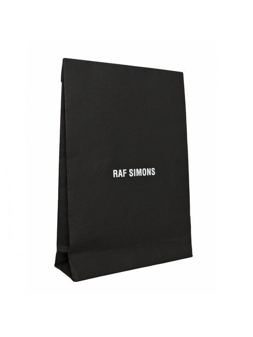 package - black and minimal design | design: Raf Simons |