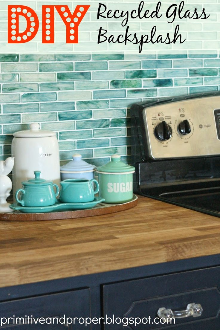 Not usually a fan of glass tile, but I love the colors in this kitchen. The wood counter tops with black cabinets get a pop of color with the ocean blue and green tiles. Also like the slate floor tiles...Primitive & Proper: DIY Recycled Glass Backsplash with The Tile Shop