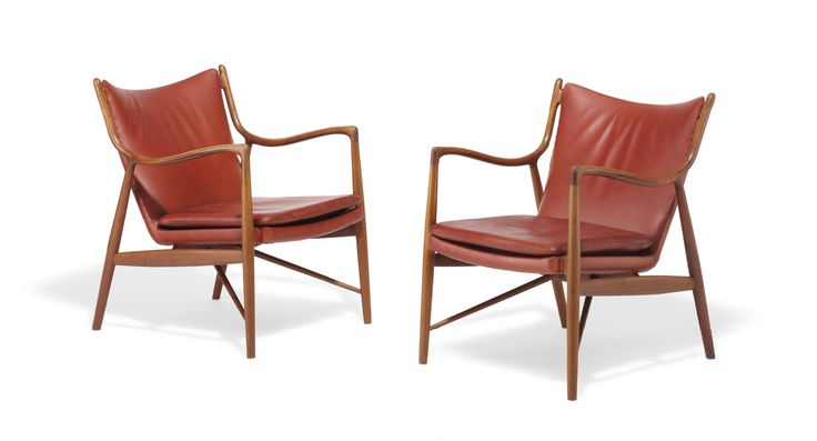 """FJ 45"". A pair of teak easy chairs. Seat, back and loose seat cushion upholstered with reddish brown leather. Designed 1945. These examples made approx. 1960 by cabinetmaker Niels Vodder, stamped by maker. (2)"