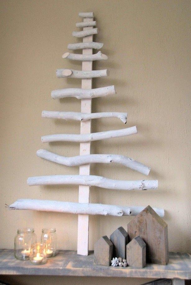 Bekijk 7 voorbeelden van een kerstboom van hout. De trend van 2016!