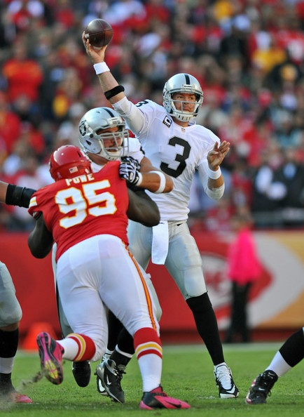 Quarterback Carson Palmer #3 of the Oakland Raiders throws a pass down field against the Kansas City Chiefs during the first quarter on October 28, 2012 at Arrowhead Stadium in Kansas City, Missouri.