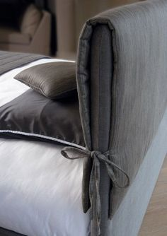 Great idea! You can change the cover without having to get out the staple gun and recover the headboard!