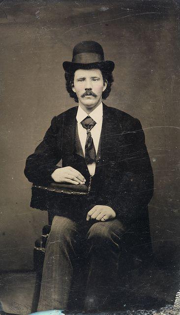 Seated man with bowler hat, ca. 1856-1900. by Fylkesarkivet i Sogn og Fjordane, via Flickr