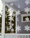 "paper snow flakes.  Could also make with colored wax paper stars ..""stained glass looking""."