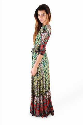 Let your style stand out in the Luxurious Queen Maxi Dress. Woven colorful fabric boasts a beautiful print with a Bohemian feel that flows all the way to a maxi-length hem.   A surplice bodice with three-quarter sleeves makes it's way to a flattering tie waist that cascades down to a graceful maxi length skirt.