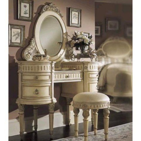 elegant and feminine and french lookin vanity! it's a little overboard for me but a toned down version would be beautiful.