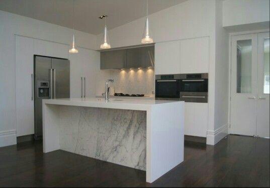 White kitchen, dark timber floors.