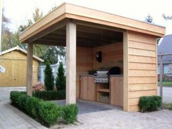 Outdoor kitchen behind new shed