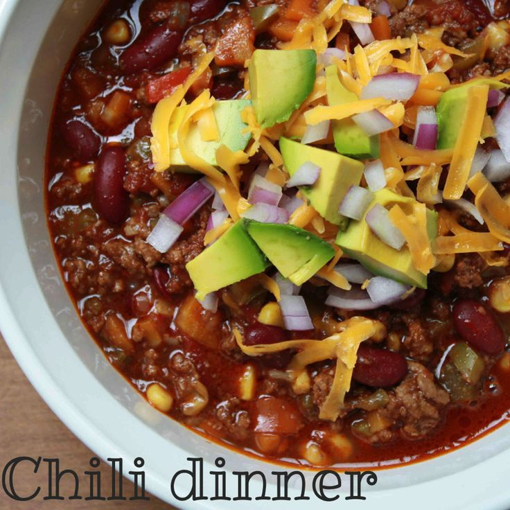Chili… It's what's for dinner. Ever just want to sit down on the couch, jammies on, feet up, and a huge bowl of comfort food like chili lathered in sour cream and cheese? Yep…