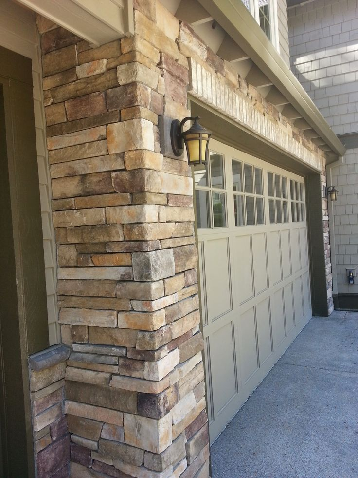 40 best bbm our projects stone veneer images on for Wood veneer garage doors