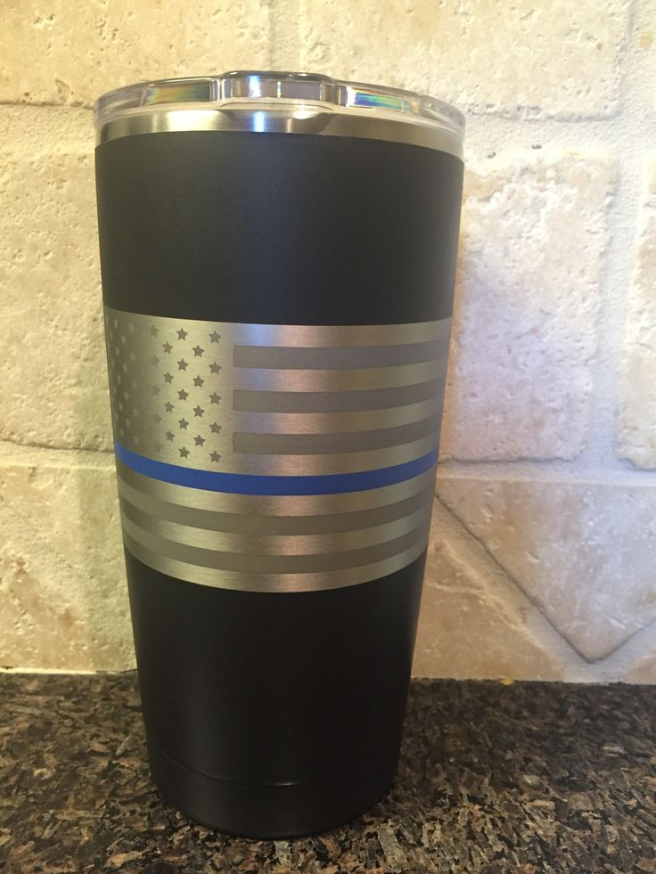 20oz YETI Rambler in Armor Black Cerakote® with the Thin Blue Line American Flag in natural stainless. Cerakote® Matte Clearcoat applied for additional protection. 10% of Net Sales from all of our Thi