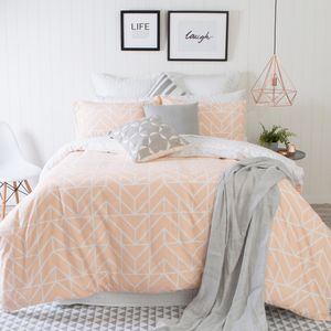 the reversible nariko quilt cover set modern style with an ontrend combination of white and apricot printed in an appealing chevron design