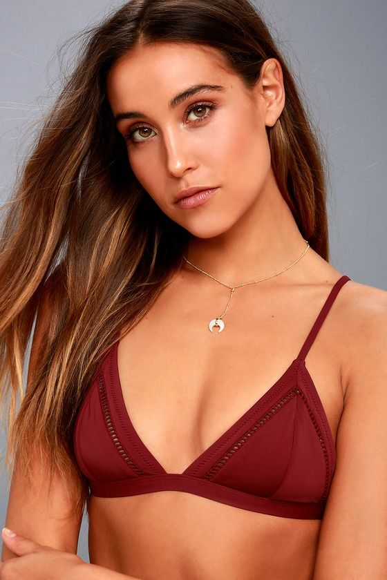 Get ready to be flooded with compliments when you wear the Rhythm My Bralette Wine Red Bikini Top! Sleek triangle bodice is accented with sheer pierced embroidery and supported by adjustable straps. Bottom band has a silver clasp closure. Small logo tag at side.