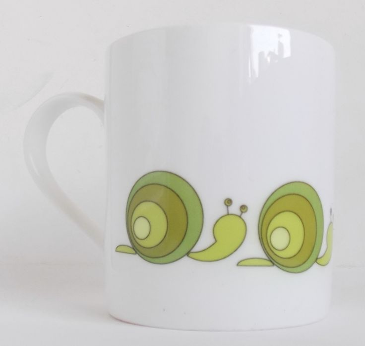 Meet Slimak, the new snail design from www.giddysprite.com Available as mugs and coasters