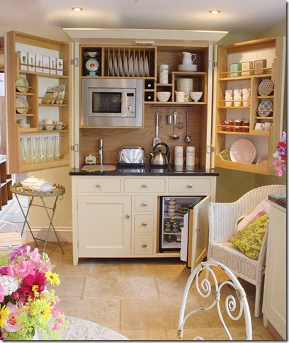 """Armoire made into a """"kitchen in a cupboard""""."""
