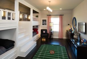 Traditional Kids Bedroom with Dalyn Rug Co. All Stars Football Ground Kids Rug, tv wall mount, Pendant Light, Carpet