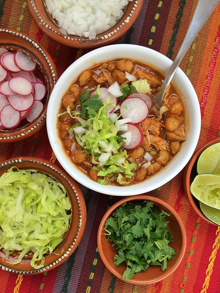 Pozole rojo is a hearty classic Mexican soup or stew, traditionally made with pork broth, pork, hominy, and spices, then topped with garnishes such as lime juice, radishes, onion, lettuce and more. It's a popular traditional dish served throughout the country that is representative of Mexican cuisine. Here's how to make pozole rojo in your slow-cooker with a semi-homemade cheat via theothersideofthetortilla.com.