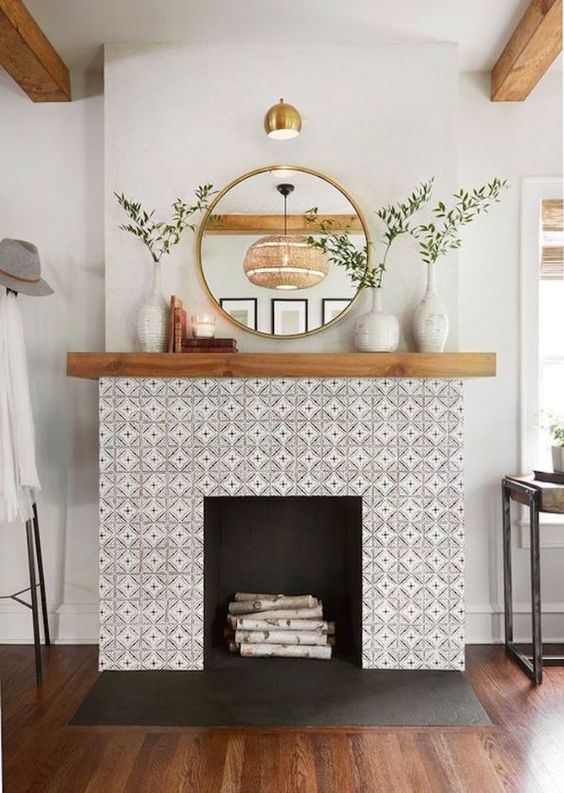 michelletakeaim fireplace inspiration, tile fireplace with mirror and plants, birch wood fireplace