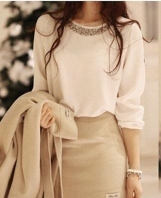 Neutrals. Beige skirt, blouse and coat. Fashion trends, new collection.