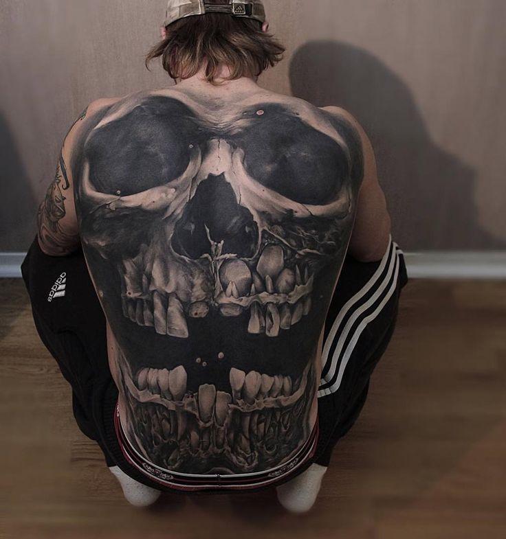 Skull back by Jens Olsson.  http://tattooideas247.com/skull-back/