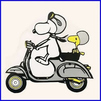 Snoopy and Woodstock riding a Vespa on their Paris Vacation.