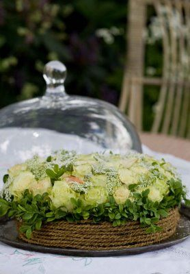 I love this idea! Centerpiece is low and won't obscure ability to communicate with guests.