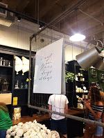 great use of a see-through object that can hold signage and visual elements! at Magnolia Marketplace.