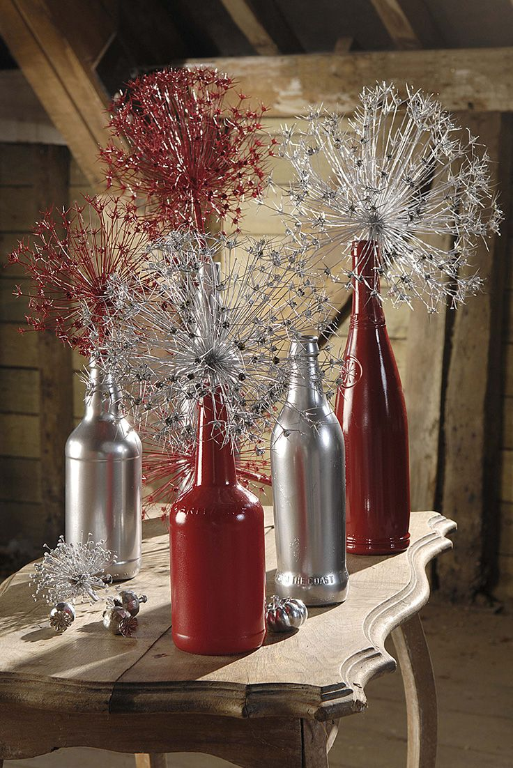 Recycled Bottles Filled Full Of Stunning Alliums This Makes An Impressive Christmas Table Centre Piece Spray P Wine Bottle Diy Bottle Crafts Recycled Bottles