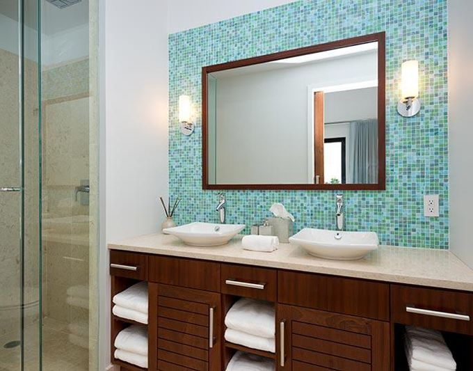 tile wall behind the mirror i love this idea makes a simple bathroom look like