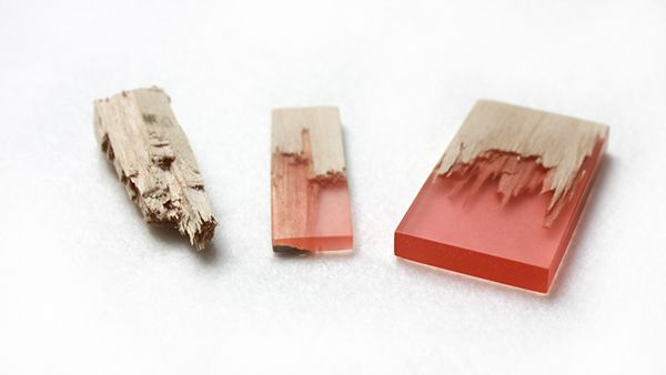 Wooden jewelry mended with colorful resin
