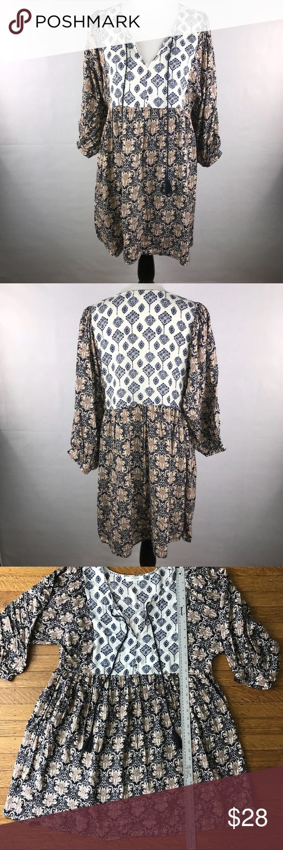 Umgee size large bohemian pattern tunic dress Really cute bohemian tunic dress by Umgee in a size large. Tassels can be tied for a more conservative look.   Festival ready outfit in a more neutral boho color palette  Size large but does look good oversized (it is NOT pinned on the mannequin) See photographs for measurements — no flaws were noted. Umgee Dresses Mini