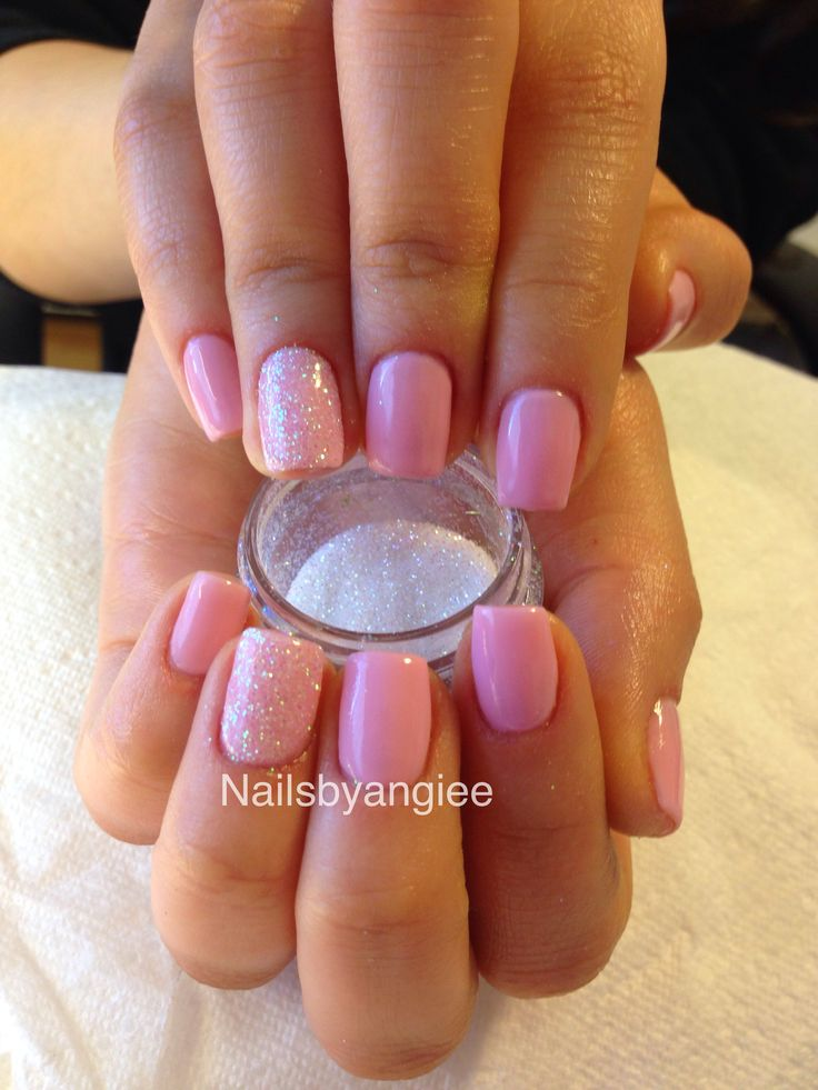 Pink gel nail color with super shinny glitter design.