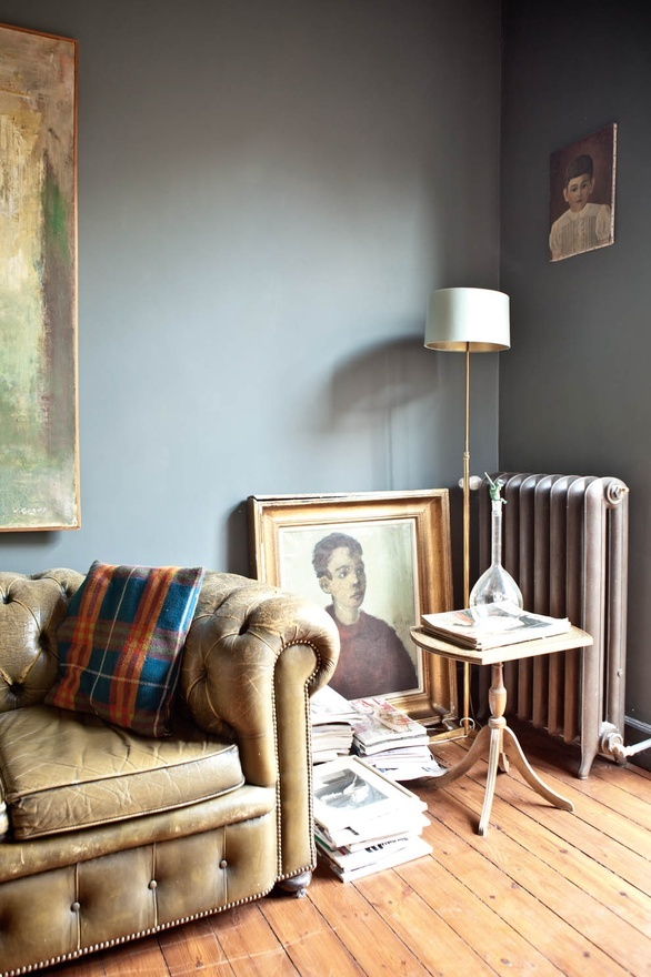 Eclectic: grey walls, vintage leather chesterfield, large abstract art