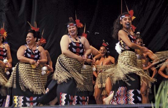 A group from Te Wananga o Aotearoa, a Maori school of higher education in New Zealand, performs kapa haka. This Maori performance art incorporates traditional forms of dancing, singing, and chanting.