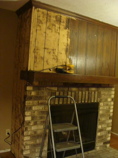 "Wood Paneling Fireplace Makeover - I'll never talk Tim into doing anything with all the :: cough:: wood paneling in the den, but there's nothing wrong with looking at some ideas. It's real wood with real grain and""character"", not cheap stuff but still, paneling, really?"
