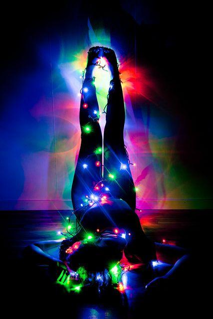 posing with christmas lights