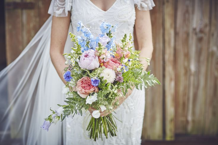 Beautiful summer bouquet with peonies and cornflowers by Brompton Buds at an amazing marquee wedding in Lympstone Devon with Danni and Joel.  #bromptonbuds #weddingbouquet #weddingflowers #summerweddingflowers #englishflowers #weddingfloristry #devonweddingphotography #farmwedding